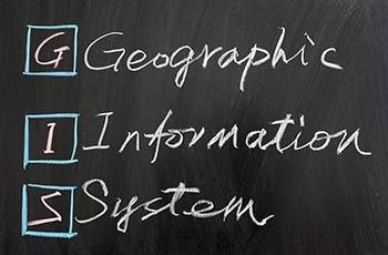 GIS written on a black board
